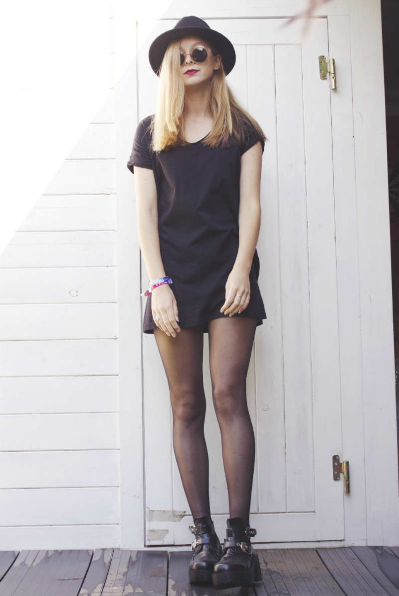 all black outfit with cut out buckle boots and fedora hat