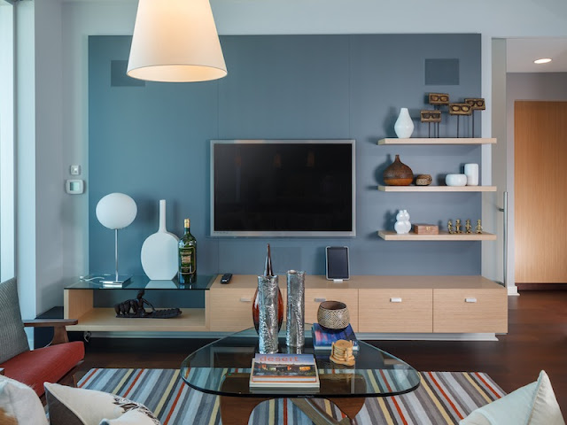 Picture of contemporary design in the living room with large tv on the wall