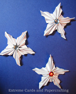 small pleated stars with jewel centers