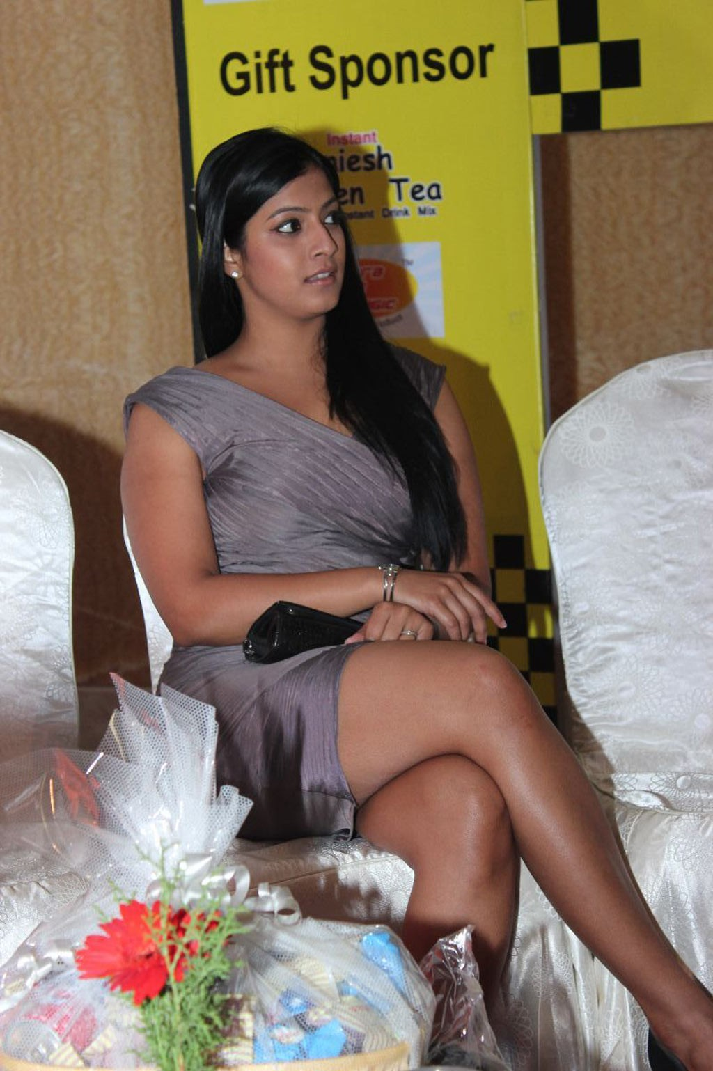 Kavya Singh cleavage exposed in a deep cut yellow tube