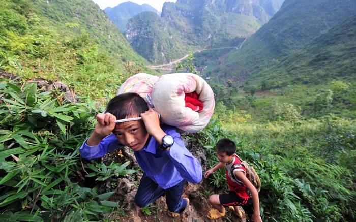 Students carry their belongings as they trek back to school from home on a rugged mountain path in Dahua Yao Autonomous County, southwest China's Guangxi Zhuang Autonomous Region. As the children live in mountains far away from the village school, most of them stay there during the school year and return home for the summer and other holidays.Picture: KeystoneUSA-ZUMA / Rex Features