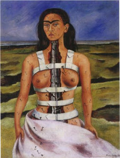 Self portrait showing Kahlo standing in a pink billowing skirt and no top. Her front is cracked open from under her chin to her pelvis, showing a cracked metal spine inside. Over her shoulders and around her torso are thick, white bands that look like some sort of stiff brace or other painful medical device. All over her skin nails are sticking out of her, and some of the nails are bigger than others, particularly those in her left breast. Below her eyes, her cheeks are covered with tears. The background shows a dark swirling blue sky, and the landscape is many shades of green and brown and looks desolate.