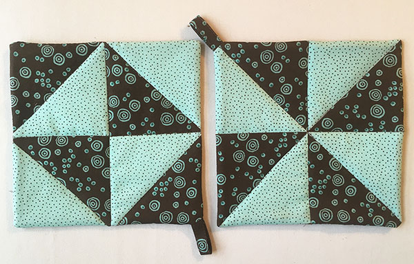 Half-Square Triangle Potholder Tutorial: A super easy beginner project. Plus she shows you a bunch of great tricks for making half square triangles fast and easy!