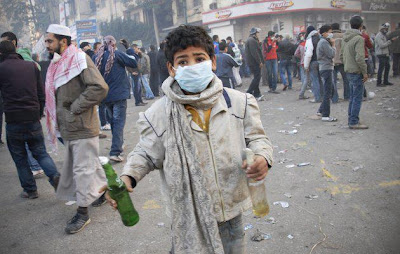 Arab Revolution Egypian Boy Holds Two Molotov Cocktails During Clash With Egyptian Riot Police in Cairo
