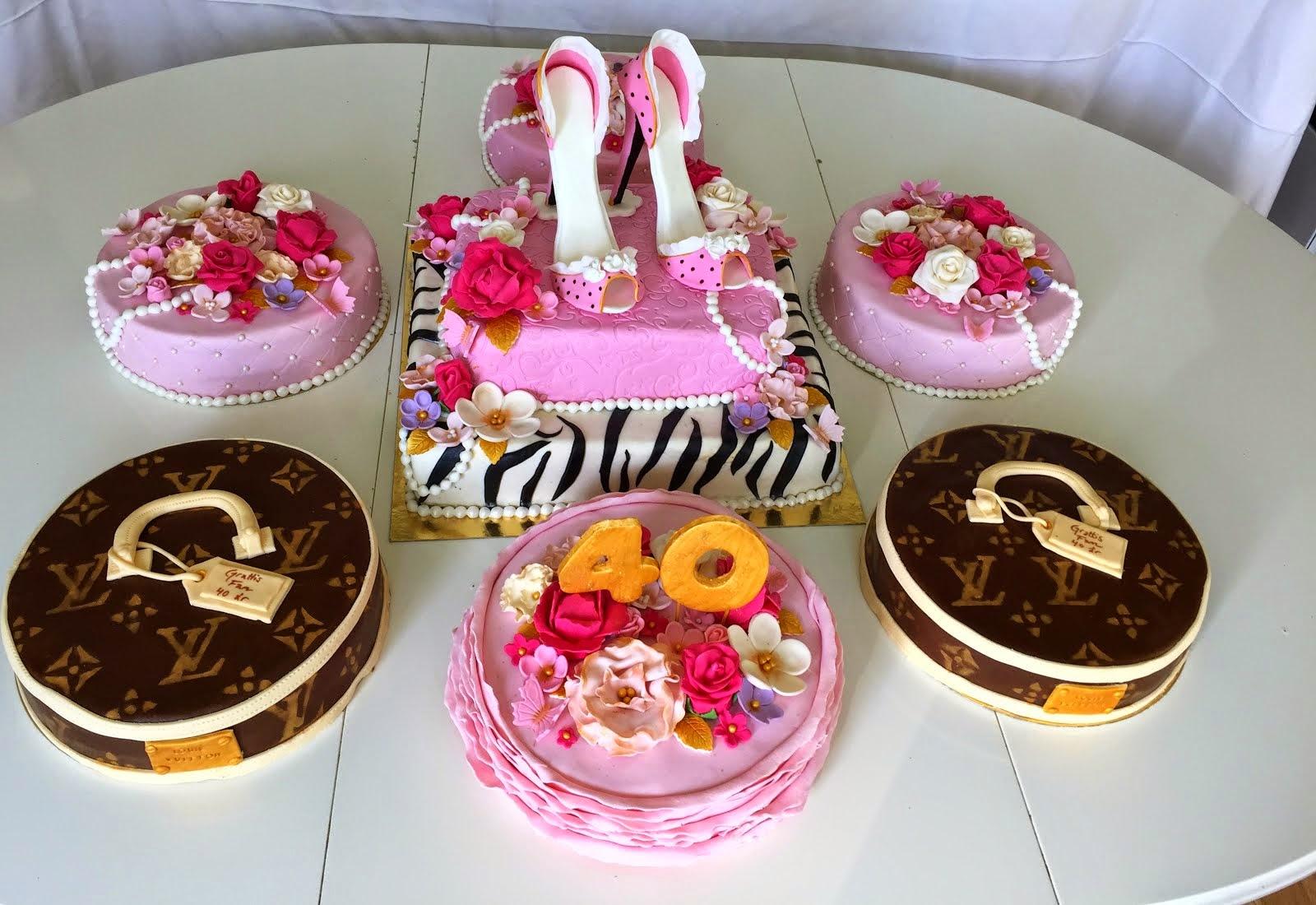 40årstårtor i rosa med kvinnligt tema