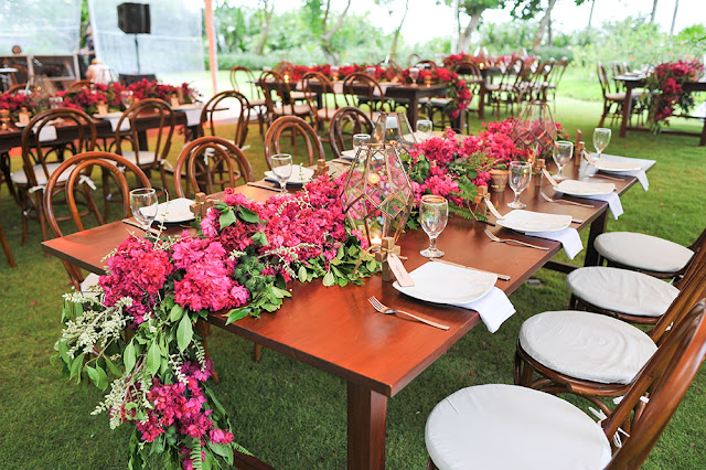 flower garland of hot pink bougainvilleas as table runner
