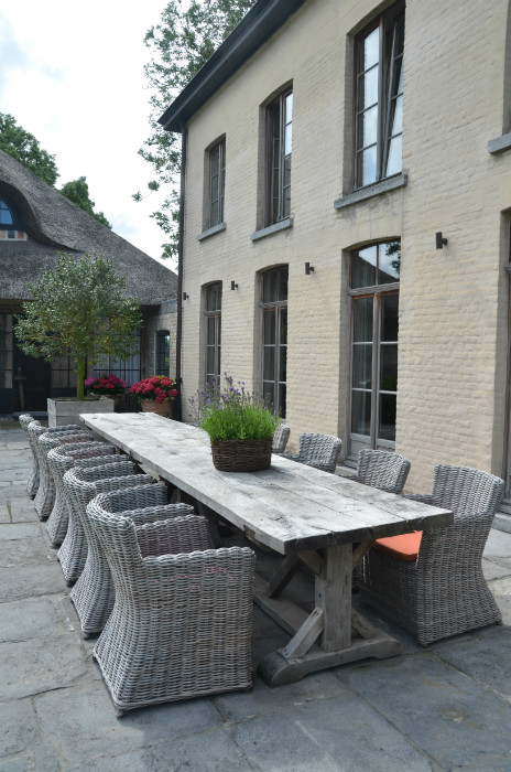 Alfresco dining at the Garnier estate &quot;Vaucelleshof&quot;, custom oak table available at Garnier (be), image via the Garnier website as seen on linenandlavender.net