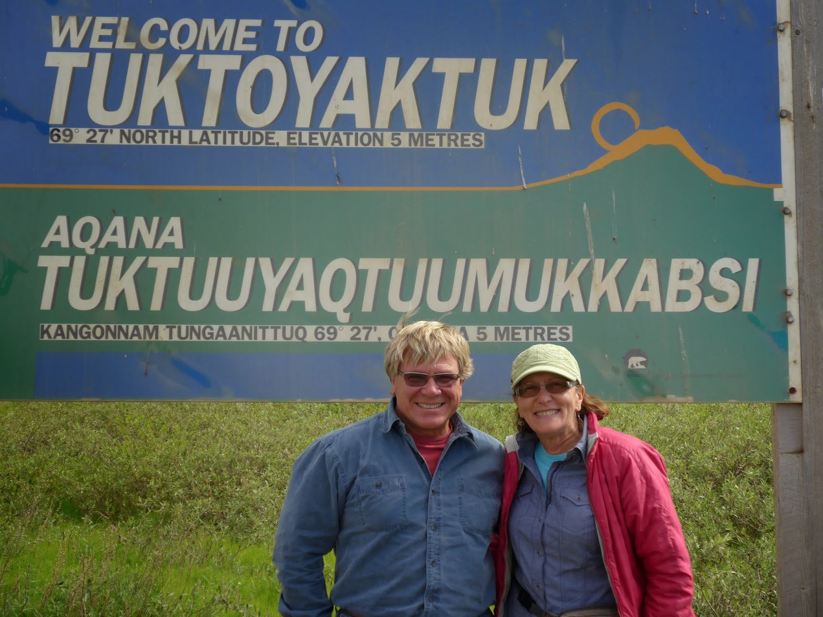 Anders and Liz in front of Tuktoyaktuk sign