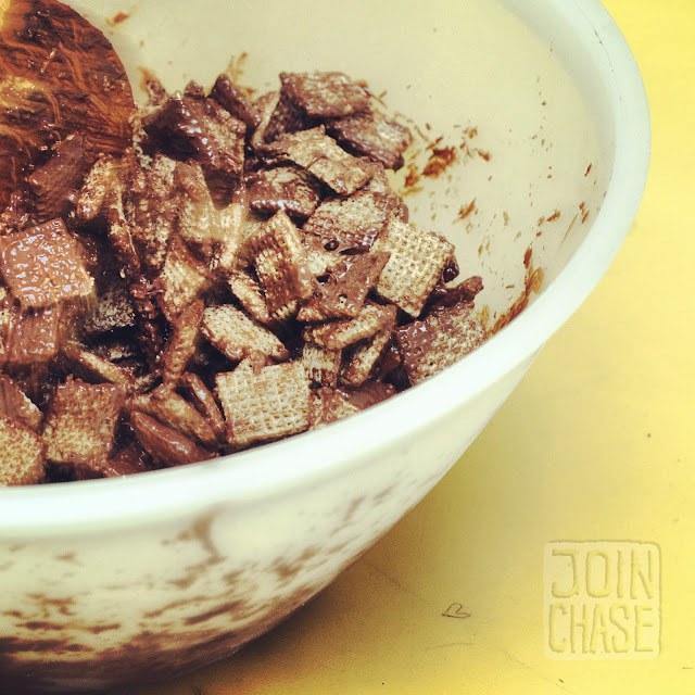 Mixing cereal and chocolate together to make Puppy Chow in Ochang, South Korea.