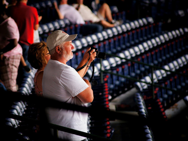 baseball fans taking photos