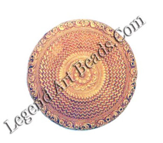 Worn on elongated ear lobes, this light thoda or thodu, measuring no less than 9 cm in diameter, is made from sheet gold worked in repousse with geometric and floral designs.