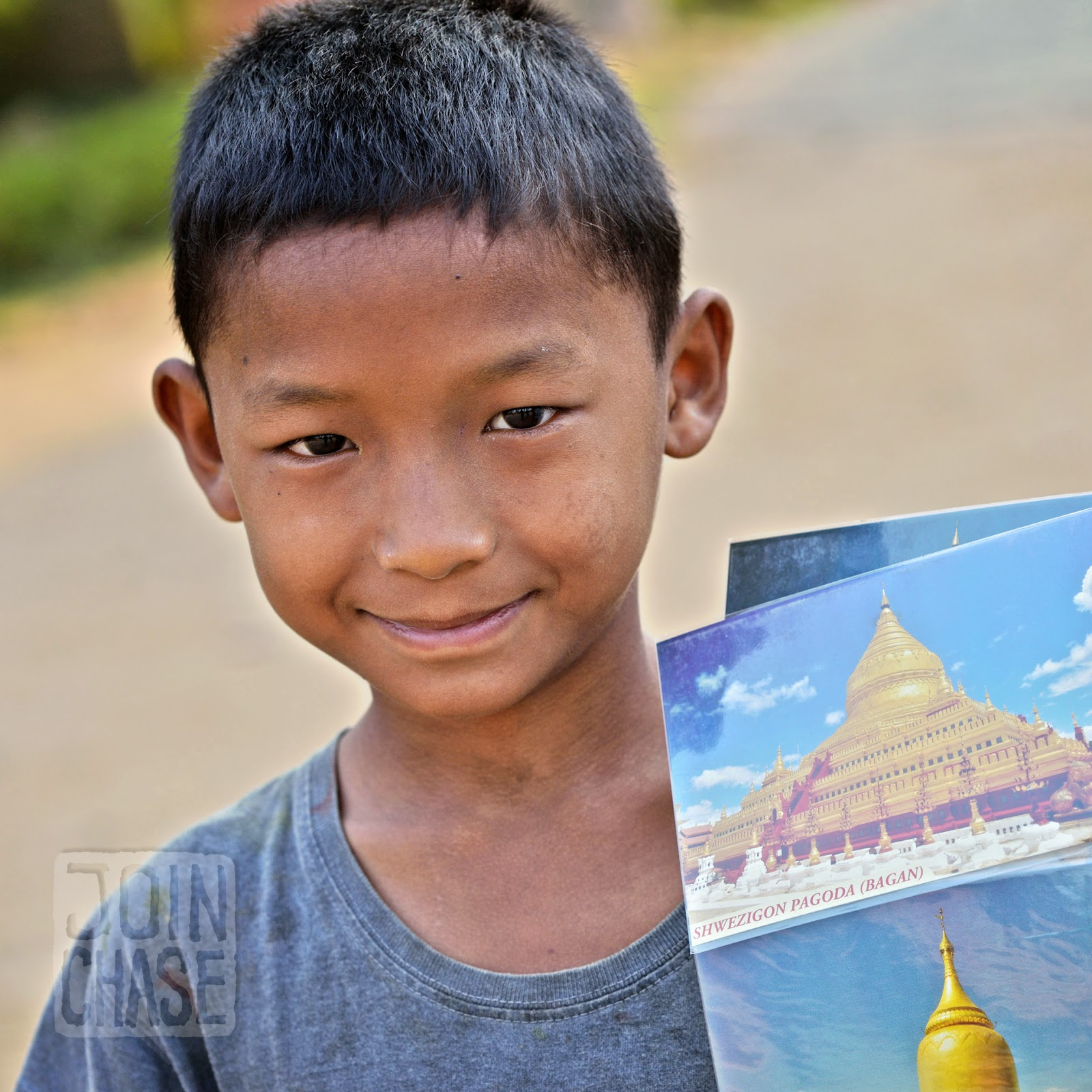 A boy selling postcards in Bagan, Myanmar.