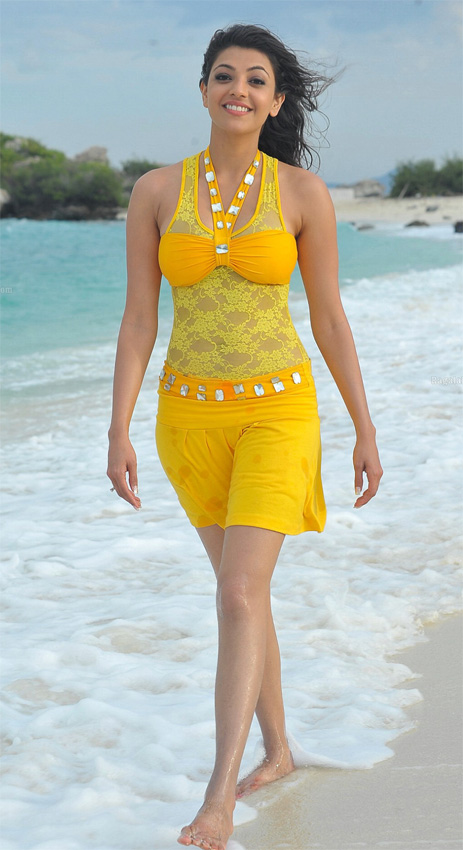 Kajal Agarwal in yellow dress1 - Kajal Agarwal Looking cute  in Yellow Dress on Beach
