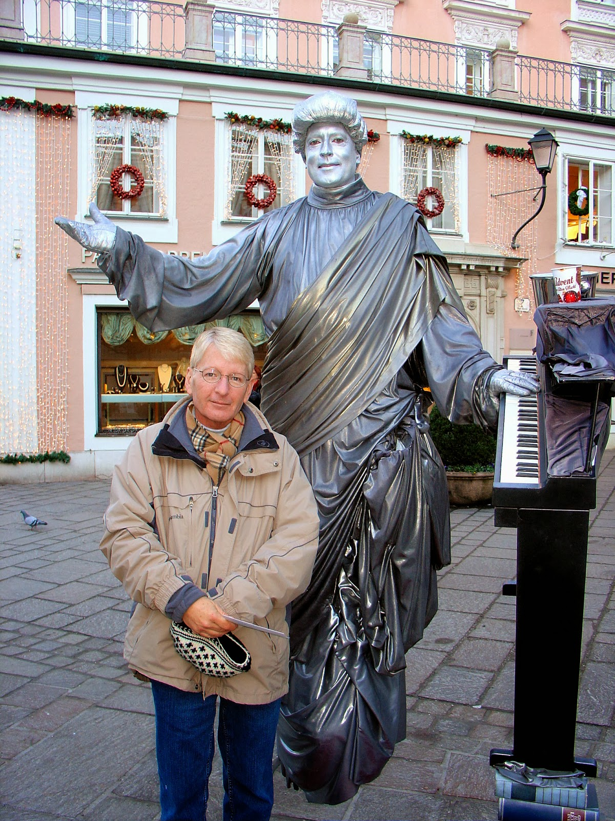 Having fun with the living statues in Salzburg. Here's Matthew with a floating Mozart?