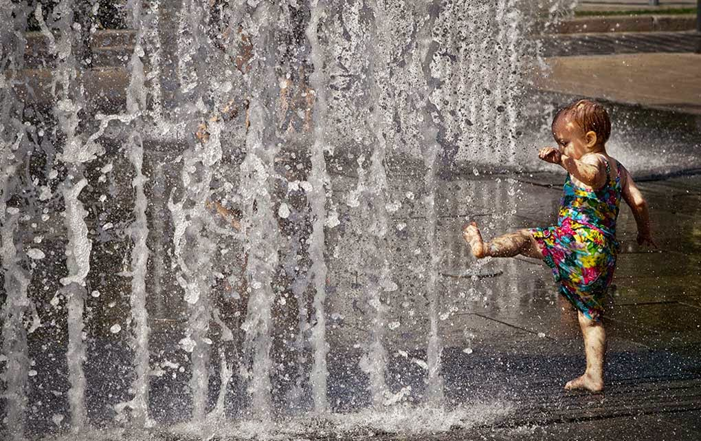 Child Playing with Water Flow