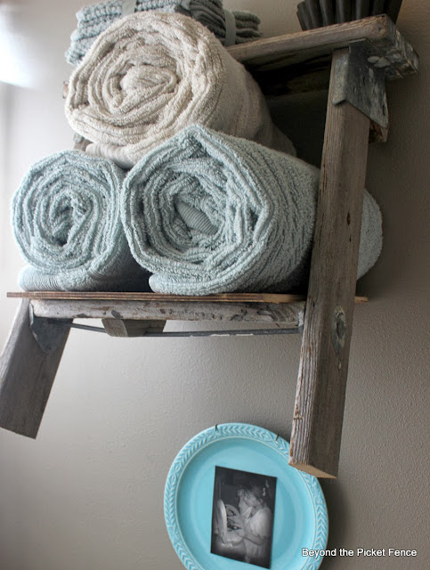 Under$75 bathroom makeover ladder shelf towel holder http://bec4-beyondthepicketfence.blogspot.com/2013/10/how-to-makeover-bathroom-for-under-75.html