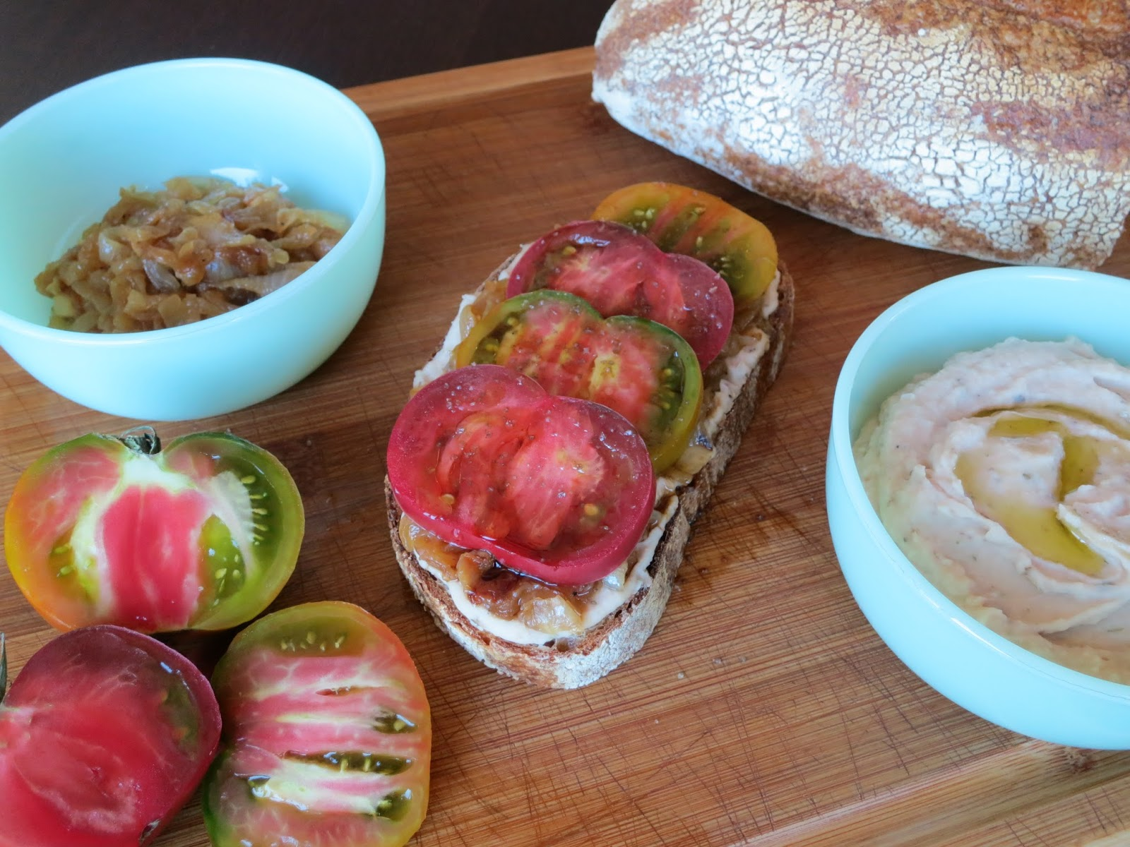 Recipe: Tomato Tartine with Caramelized Onions and Creamy White Bean ...