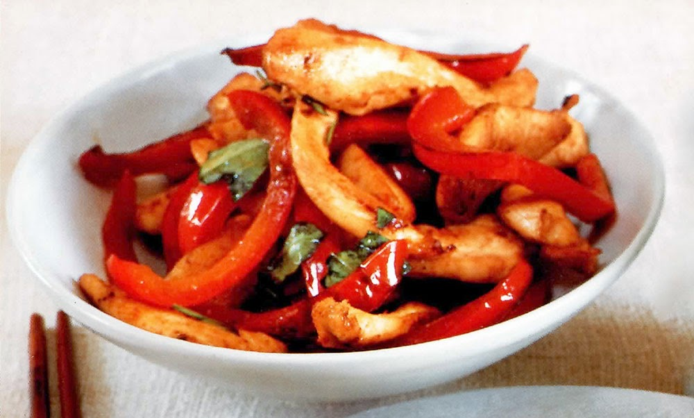 Stir-fried Chicken with Thai Basil: A classic Thai-inspired stir-fry dish of chicken and red bell pepper in a chilli, fish sauce and lime juice base finished with Thai basil. Very quick to make, this is a great week-night family dish.