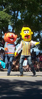 Bert and Ernie from Sesame Street holding hands with a marriage contract