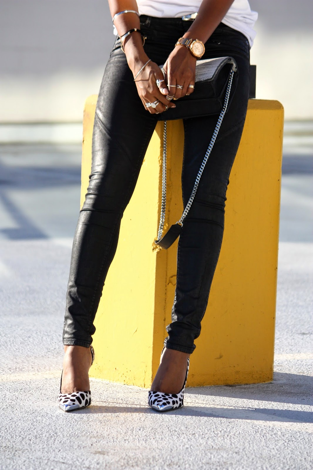Wearing H&M waxed finished jeans Guess metal cap-toe pointed-toe pumps