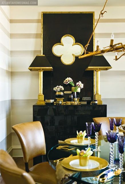 white walls in dining room with gold and black accents