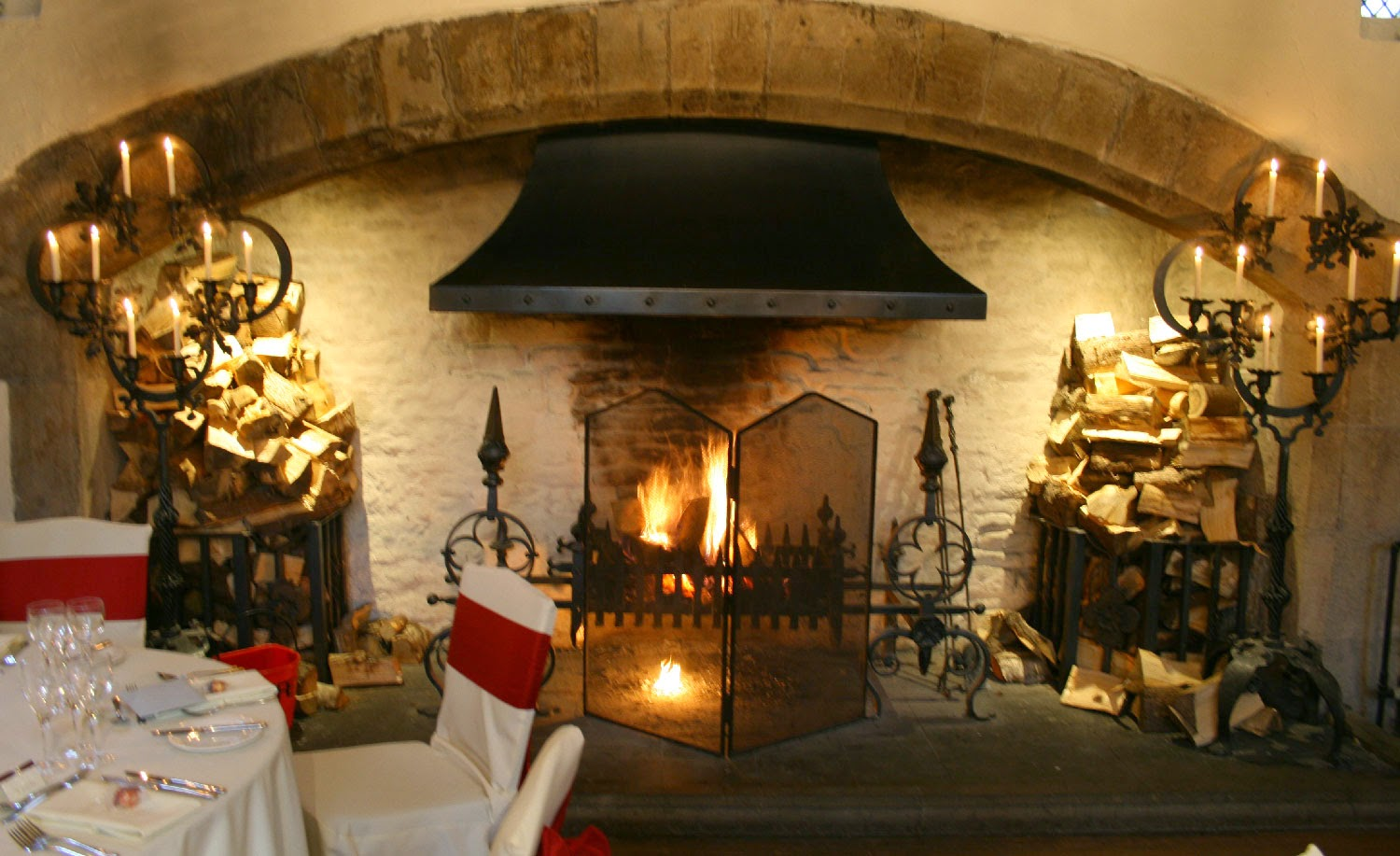 Blazing fire in the impressive fireplace