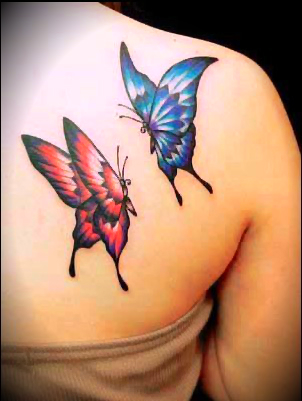 a tattoo featuring one blue and one red butterfly chasing each other