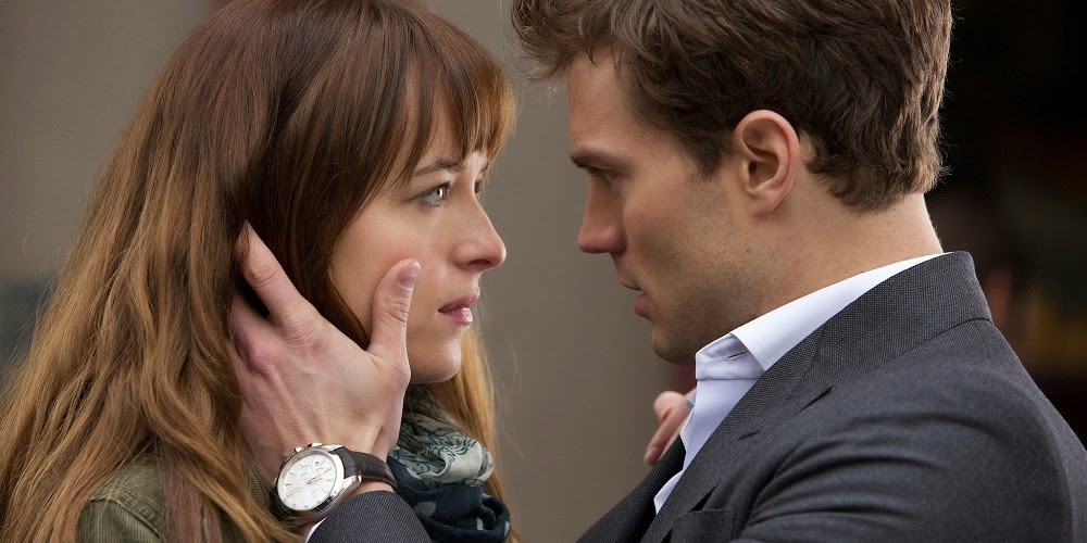 Dakota Johnson e Jamie Dornan em CINQUENTA TONS DE CINZA (Fifty Shades of Grey)