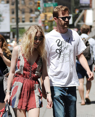 Dakota Fanning shows off legs in a Union Jack romper with boyfriend in Soho