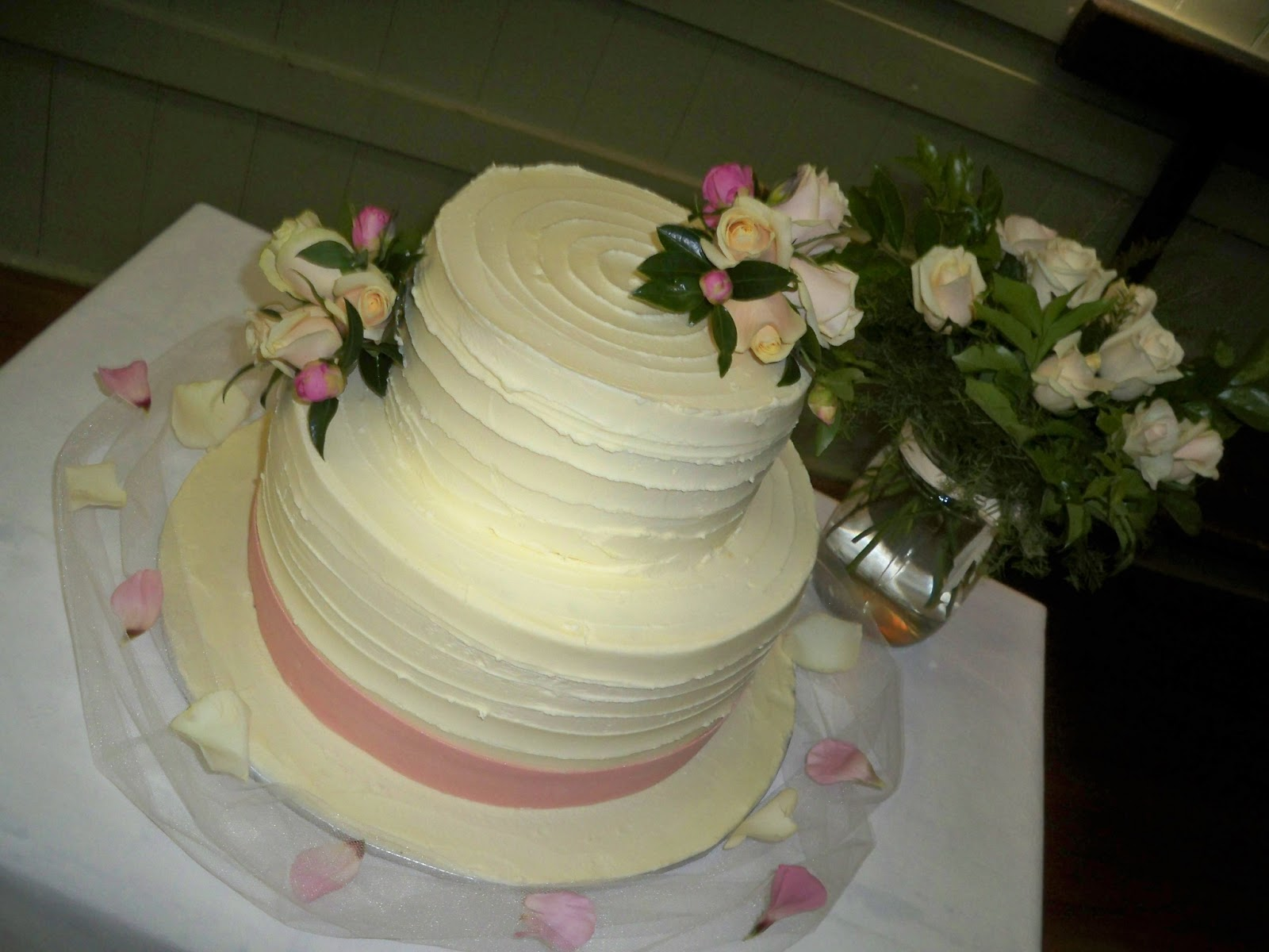 simple white chocolate ganache wedding cake with pink roses ...