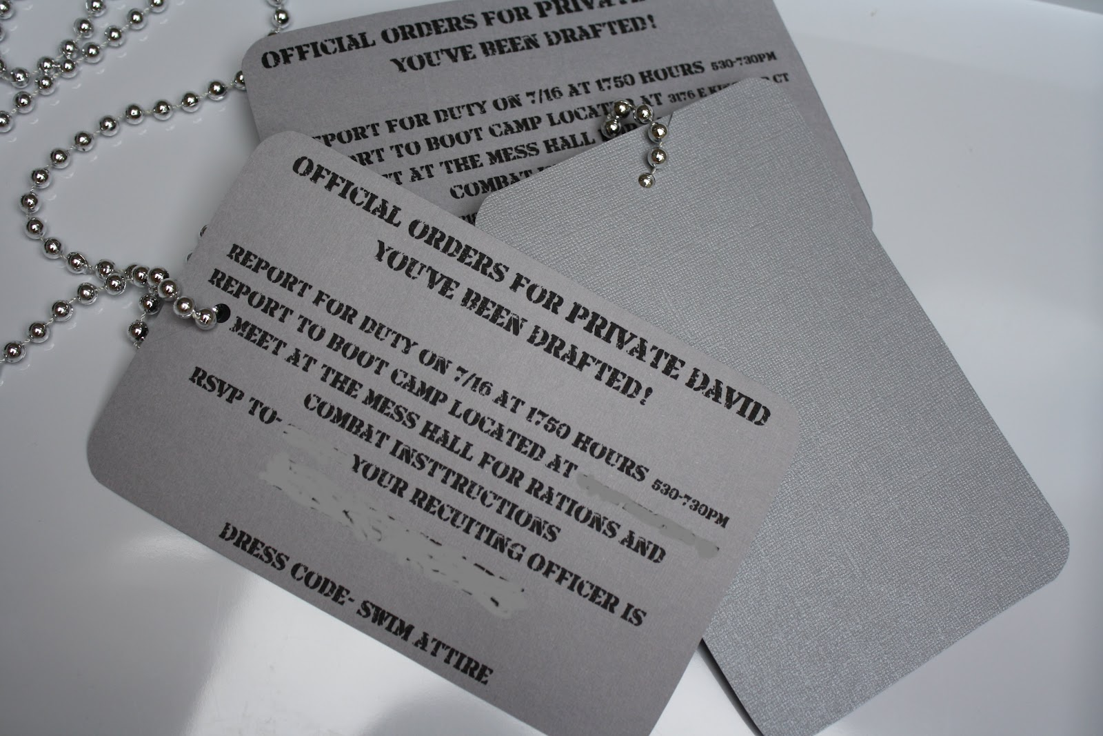 These invites were made to look like dog tags. I printed them each on a single sheet of grey paper. Then I hole punched them, cut a small slit and slipped ...