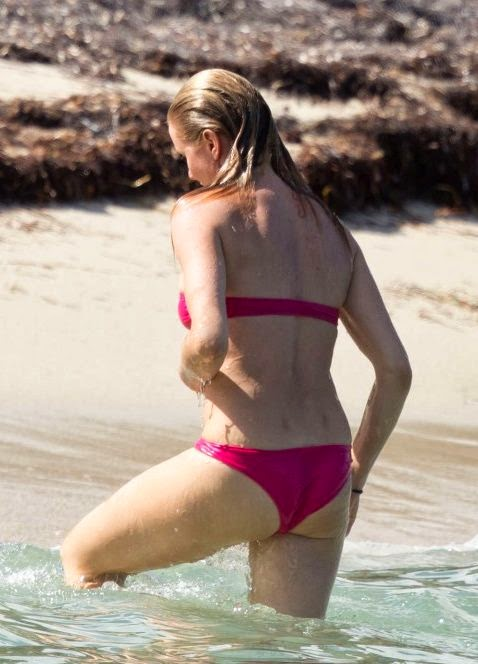 Cameron Diaz goes barefoot in a Blue Bikini as she enjoys beach party in the Caribbean