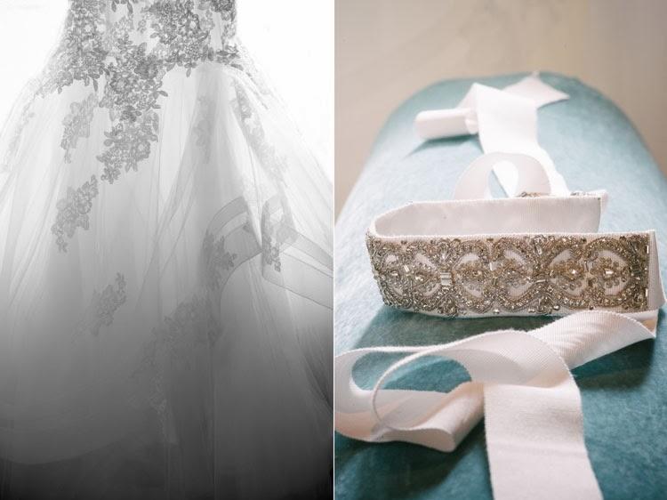 Monique Lhuillier wedding dress and crystal sash on blue velvet pillow