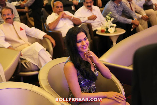 Veena Malik At Sahara's News channel- silver dress