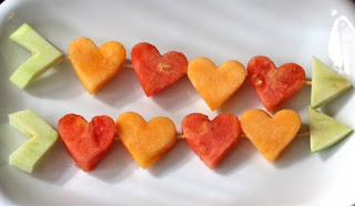 http://www.babble.com/best-recipes/heart-shaped-food-day-9-shot-through-the-fruit-hearts/