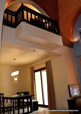 Dining area and Mezzanine in a One-Bedroom Villa at The Cove Rotana