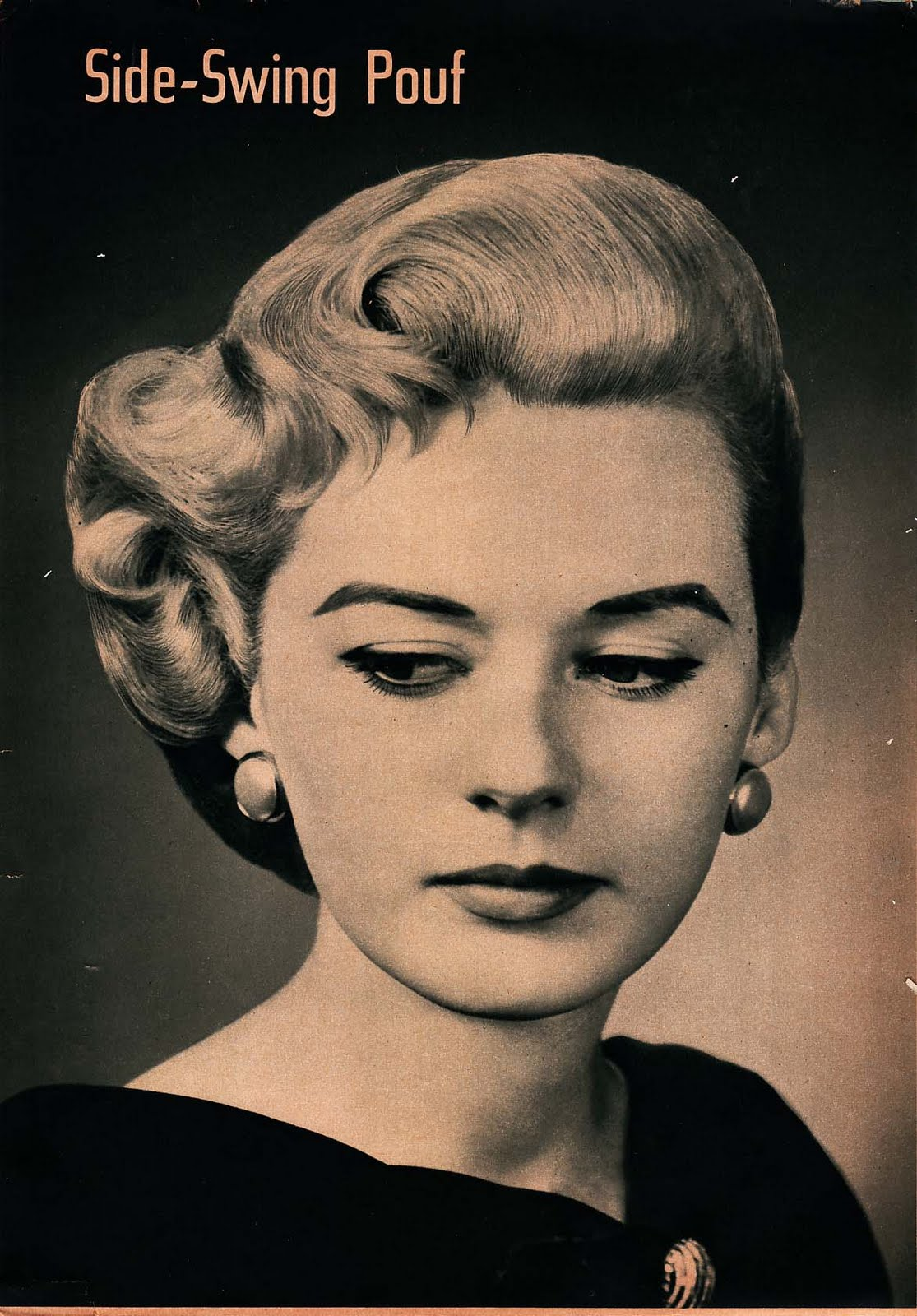 Vintage: Pomps, Curls, and Waves: Intricate Hairstyles of the 1940's title=