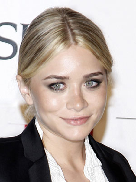 Ashley Olsen's smooth, center-parted style looks prim and polished with a low, neat bun.