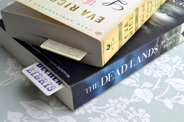 Stack of two books with bookmarks in