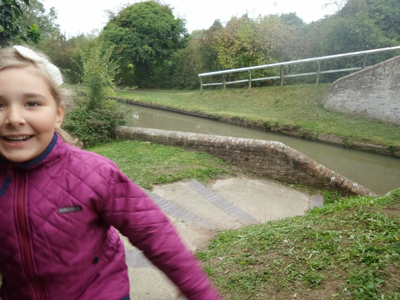 Top Ender bounding up the Canal Towpath in her Muddy Puddles jacket