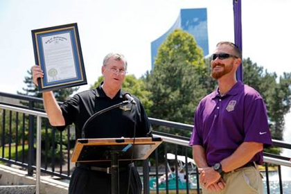 "Crown Royal's ""Your Hero's Name Here"" winner and Brickyard 400 race namesake, U.S. Marine Corps Sergeant Jeff Kyle, right, is honored by Indianapolis Mayor Greg Ballard with the proclamation of Jeff Kyle Day  in Indianapolis, Friday, July 24, 2015. (AJ Mast /AP Images for Crown Royal)"