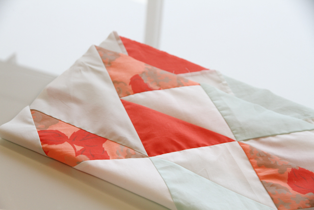folded modern mint and coral aztec quilt top   by Lovely and Enough