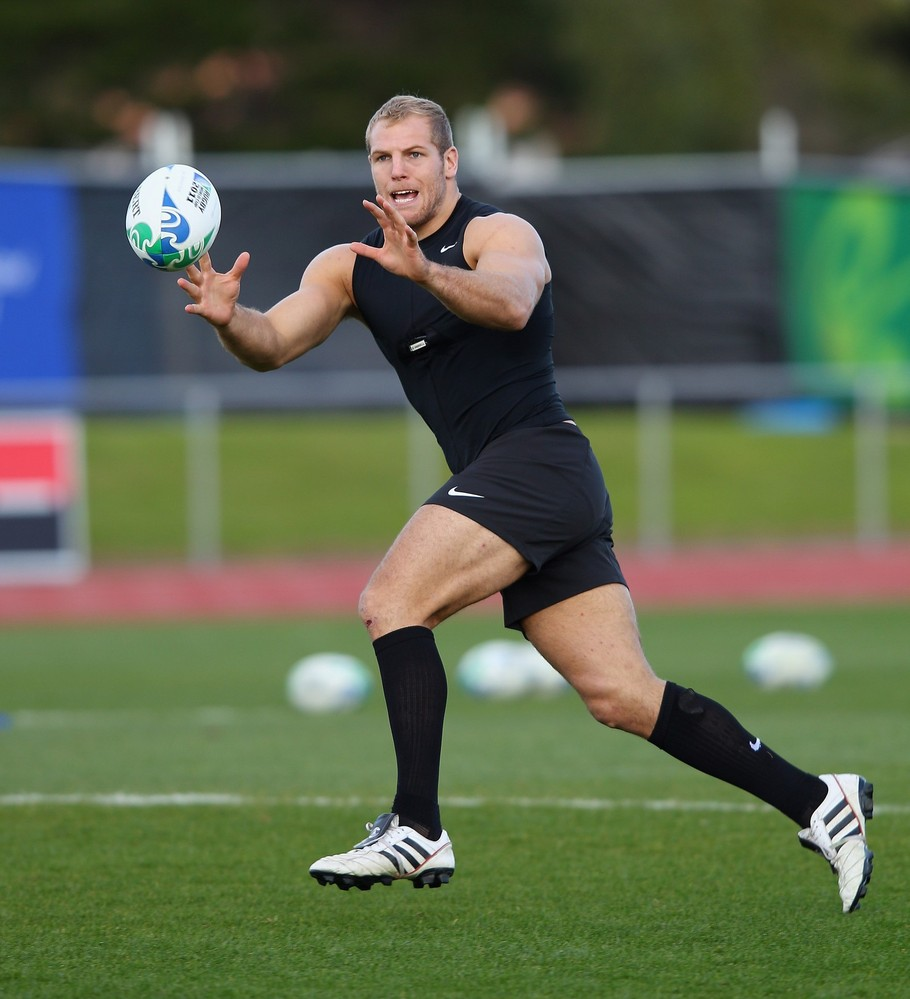 Hunky, Muscular Rugby Player In Practice