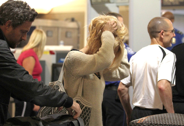 Pamela%252BAnderson%252BPamela%252BAnderson%252BJon%252BRose%252BArriving%252BCg90k8BSWD6l Pamela Anderson and Jon Rose Arriving for A Flight at LAX [April 28, 201]