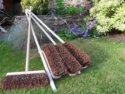 Four garden brooms