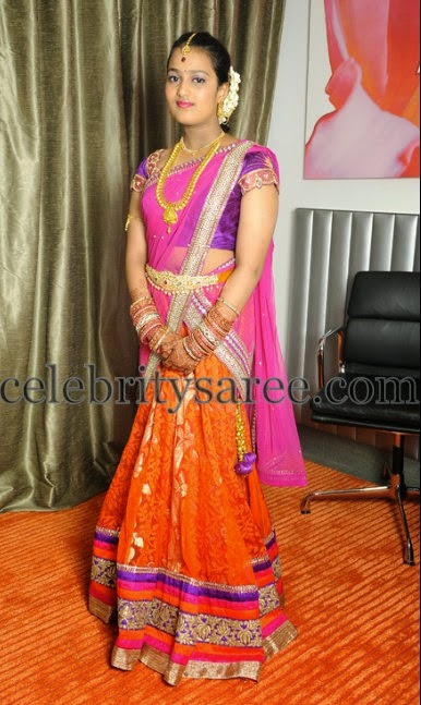 Bride in Orange Brasso Half Sari