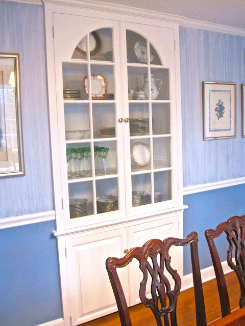 The dining room has a built in china cabinet so charming