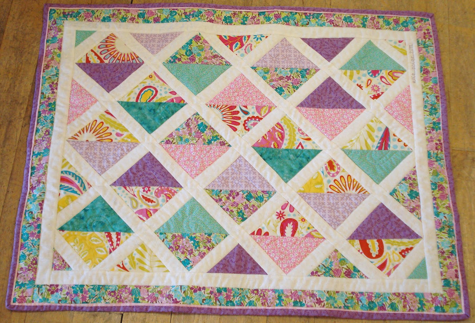 quilt it s a little pram sized quilt you can find the pattern here on Quilt Patterns Charm Packs Free