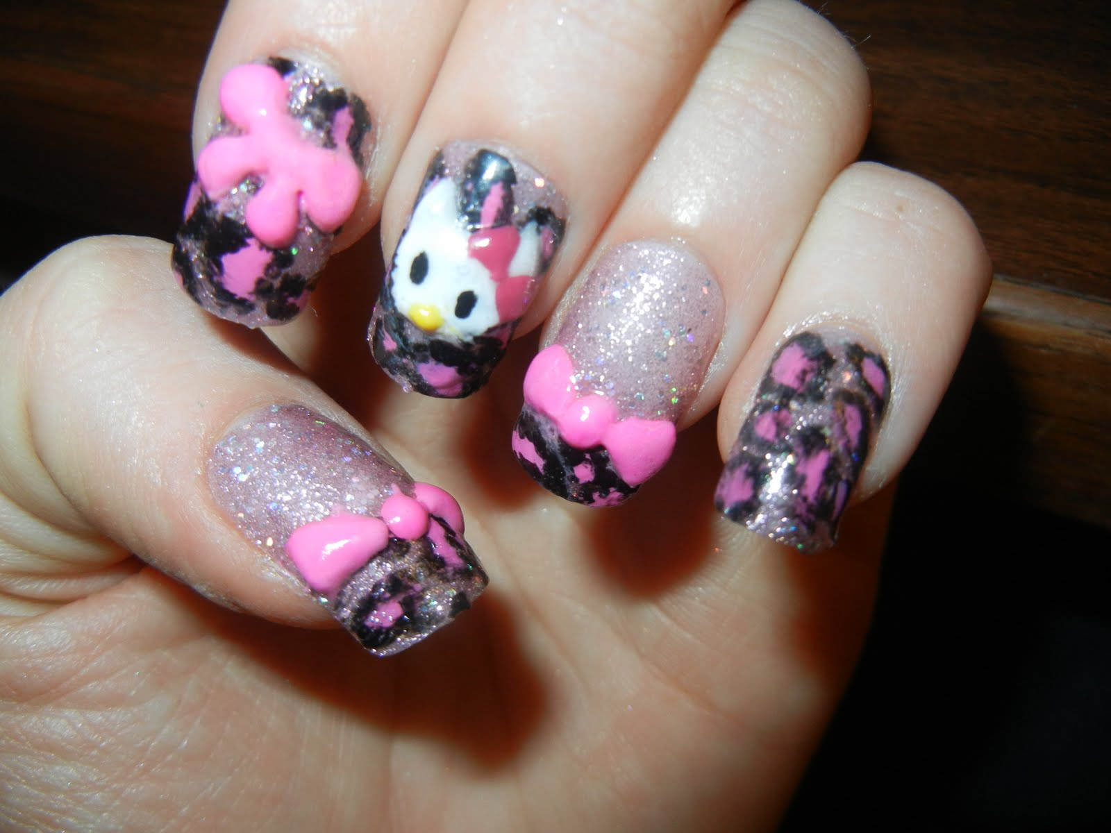 new hello kitty nails 3d bows and hello kitty face over pink glittery    Hello Kitty Nails With Bow