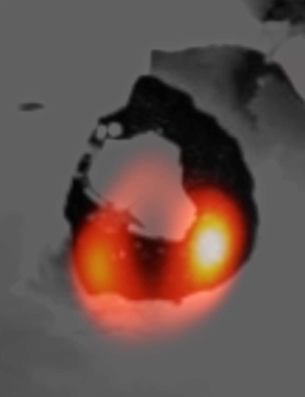 The LBT image of the Loki lava lake (orange) laid over a Voyager image of the same structure (dark shade). Credit: LBTO / NASA